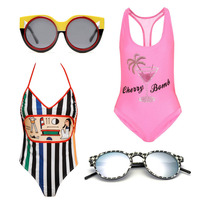 This Season's Best Graphic Swimwear + Sunglasses