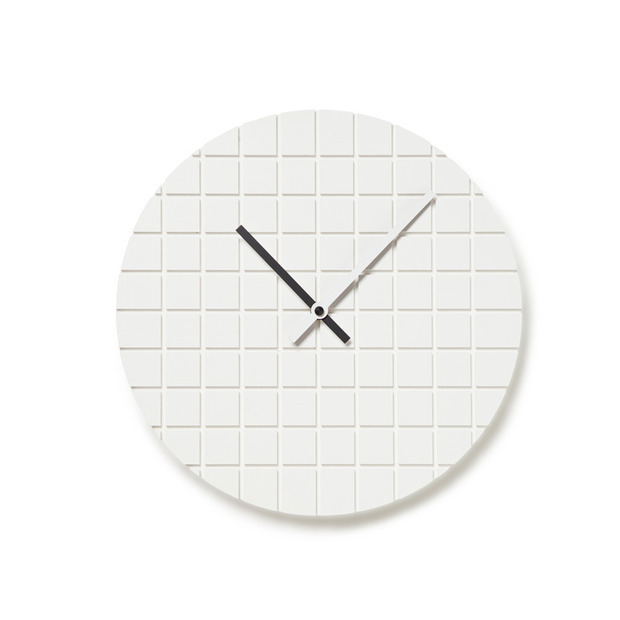 Assembly Design's 00 Clock: Juxtaposing measurement and abstraction, a grid wall-clock with reversible hands