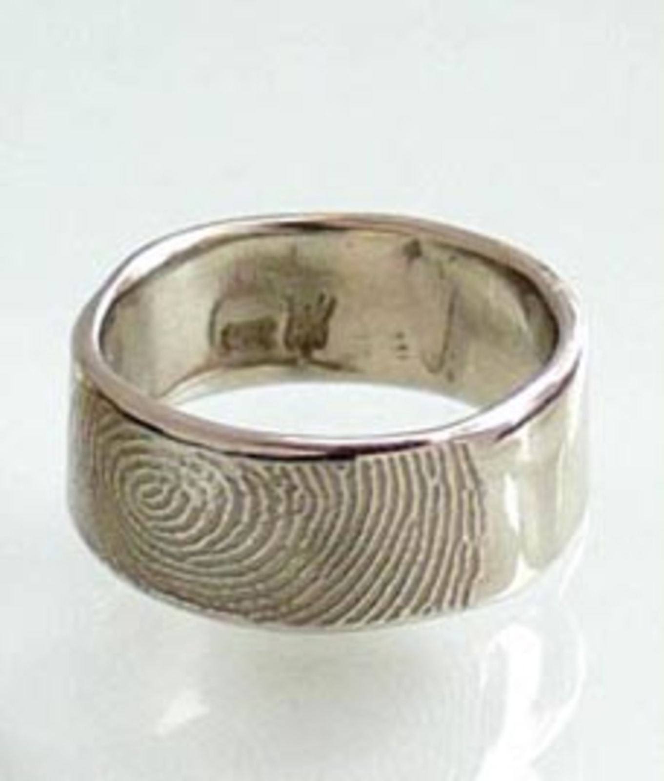 ring on band rings photo trend traditional bands spin wedding personal fingerprint puts kehrnal qalltzm