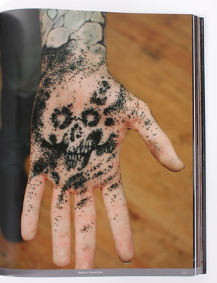 Black-Tattoo-Book-2-hand.jpg